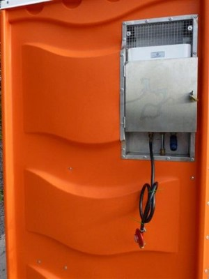 Hot Water Dispenser. Back view of Portable Toilet from Griffin Toilet Hire