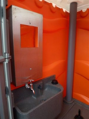 Sink and Hotwater Dispenser of Portable Toilet from Griffin Toilet Hire