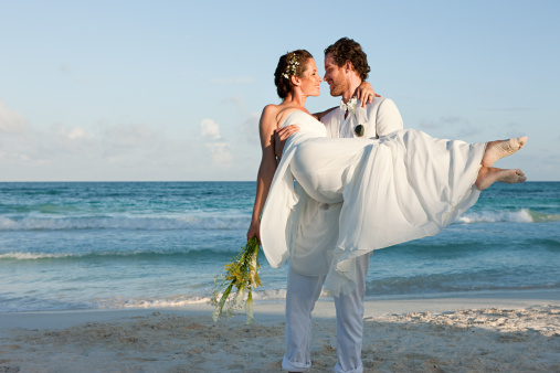 Married couple on beach Destination Wedding