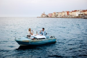 1. Piran Couple dining on a boat