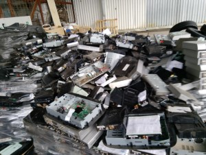 A mountain of e-waste comprised of broken and old DSTV and GoTV boxes